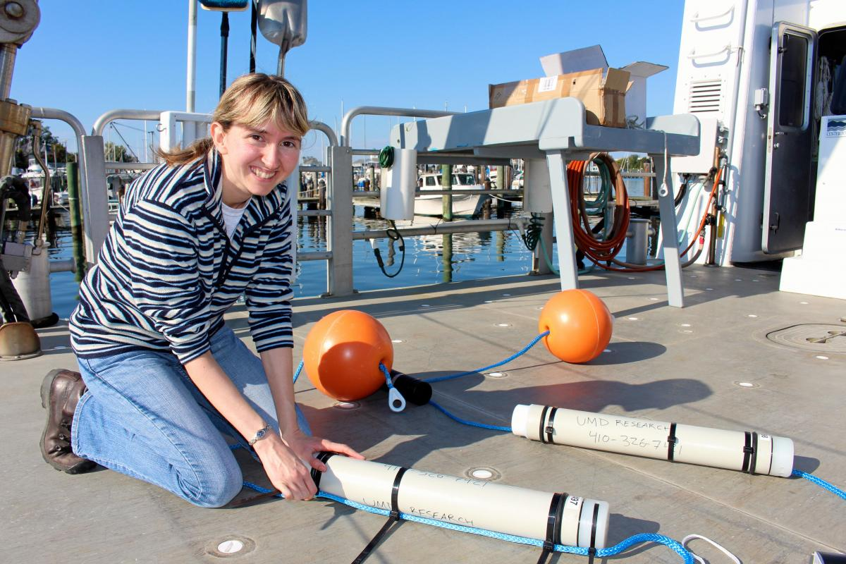 Woman setting up research instruments on docks