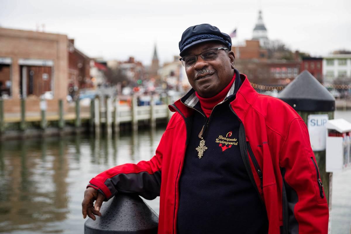 Closeup of Vince Leggett in red jacket beside dock