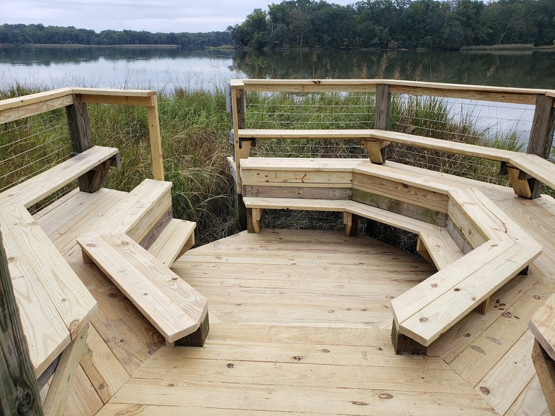 octagonal wooden sitting area in marsh overlooking river
