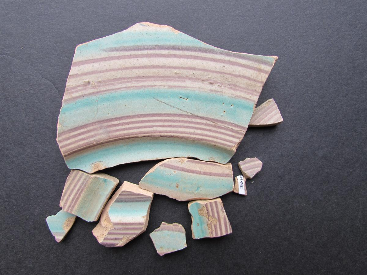 Many sherds of blue and purple ceramic