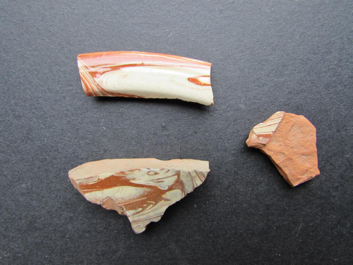 Three sherds of slipware ceramic