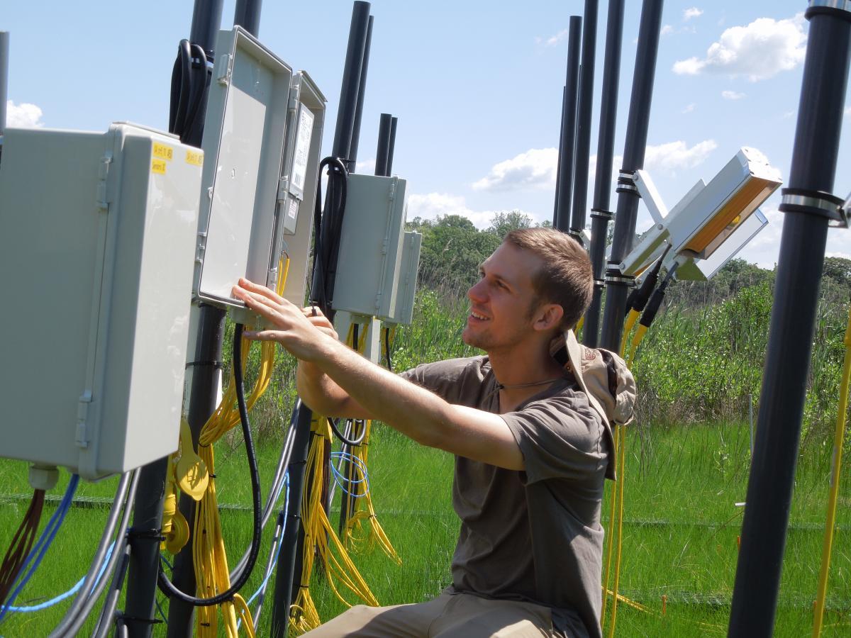 Joe Dawson with control box on Global Change Research Wetland
