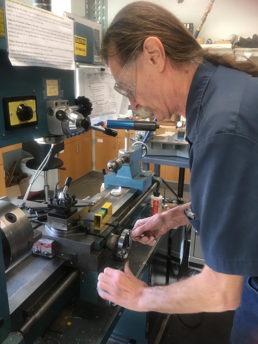 volunteer uses machinery