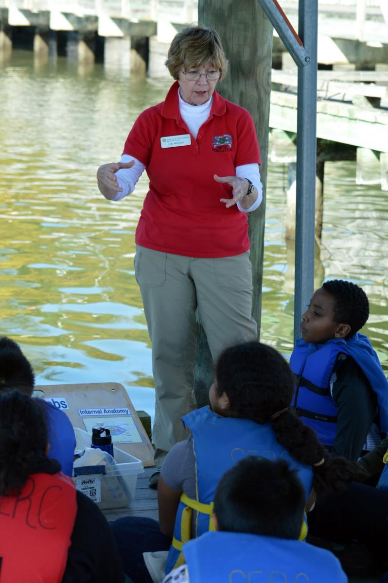 SERC education volunteer teaching students about Rhode River ecology
