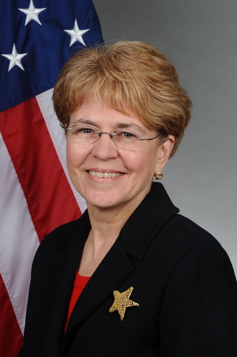 Head shot of Jane Lubchenco in front of American flag