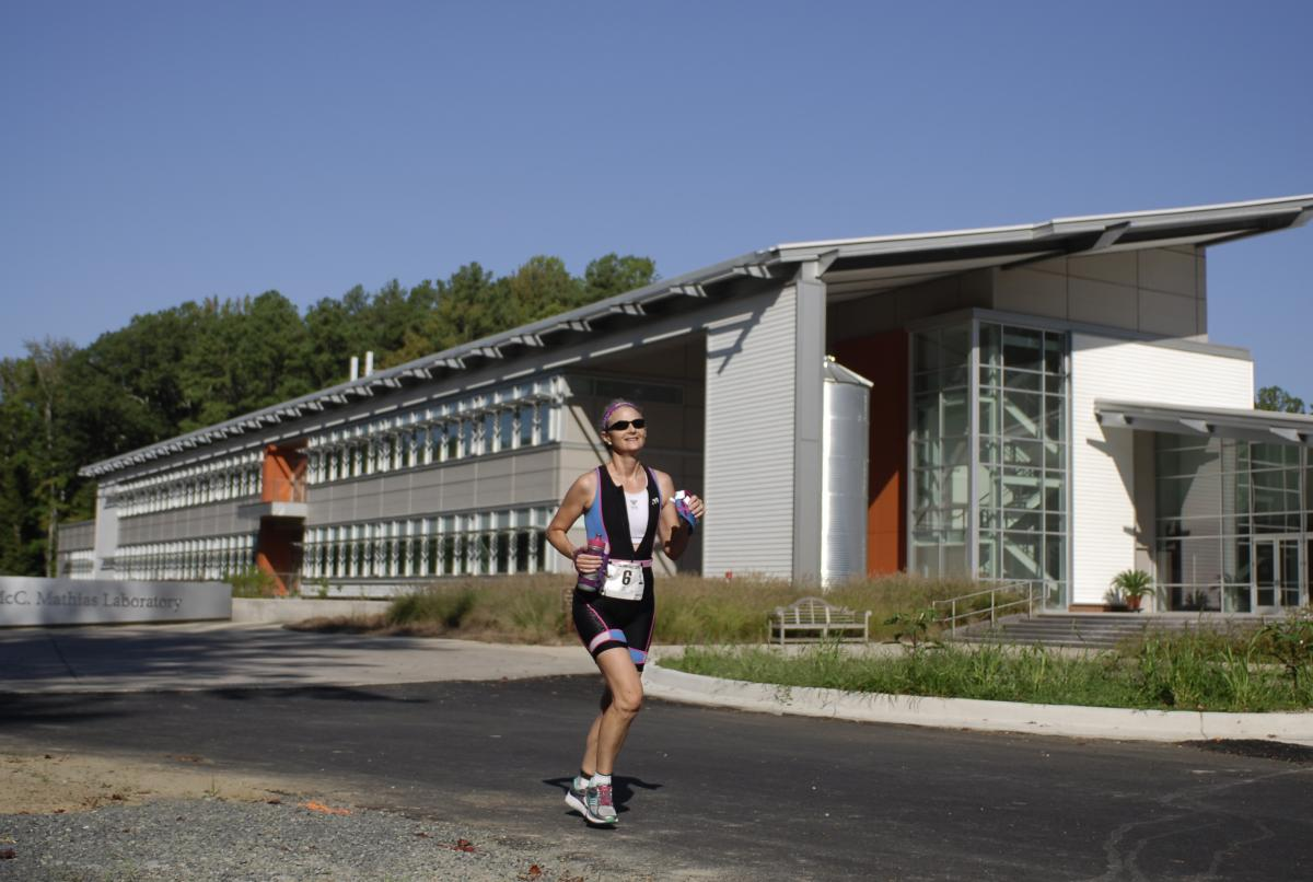 Woman running in front of Charles McC. Mathias Laboratory
