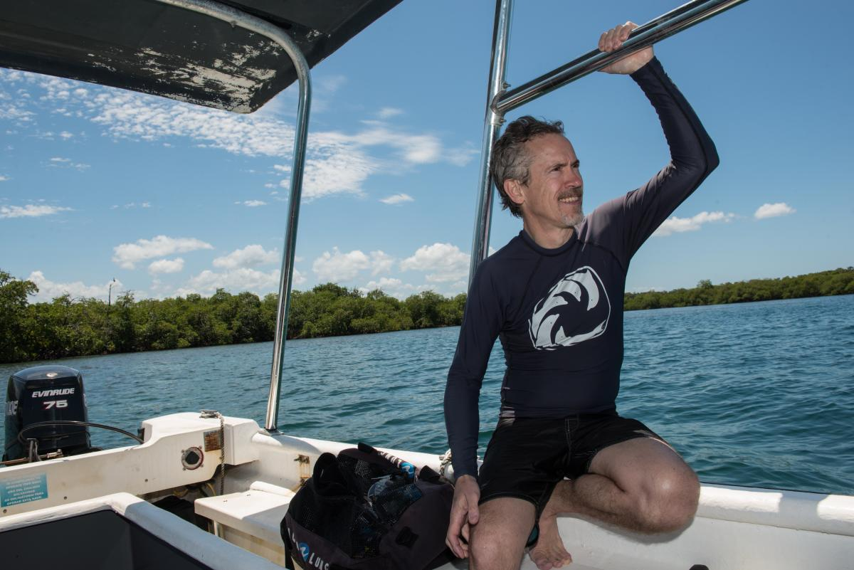 Man in wetsuit on boat