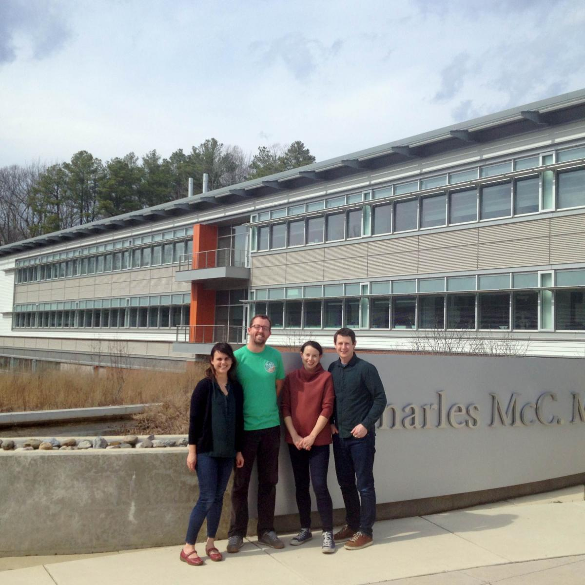 Four scientists in front of Mathias Lab building