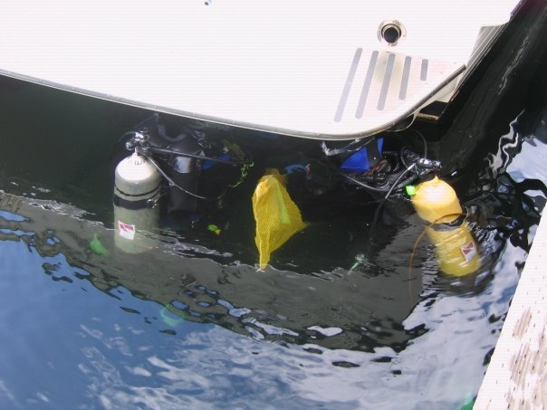 Research divers collecting samples from a small boat.
