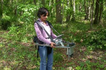 Rehanna Chaudhri with Portable Canopy LIDAR in forest