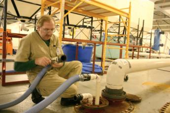 Tim Mullady setting up a ballast water experiment