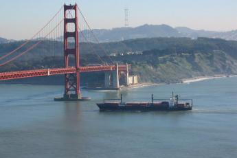 Ship passing under the Golden Gate Bridge