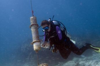 Our team visits a passive acoustic recorder near a coral reef