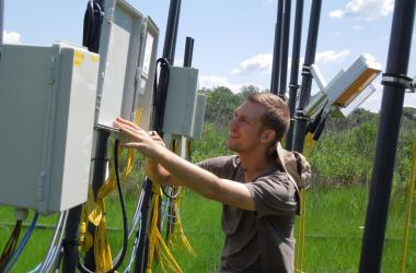 Joe Dawson with control box on Global Change Research Wetland