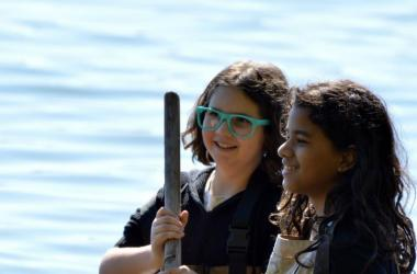 Two middle school students learning how to seine for fish and invertebrates