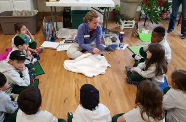 Jillie teaches students about terrapins.