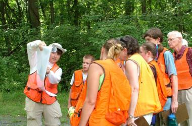 Group learning about SERC forest ecology from volunteer
