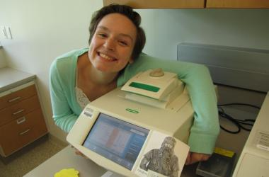 student smiling with machine
