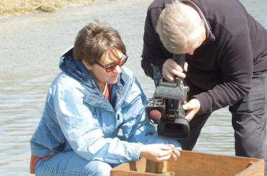 Filming mud crab collection on the dock
