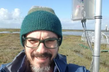 Roy Rich in jacket on wetland