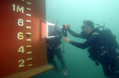 Greg Ruiz surveys a ship's rudder