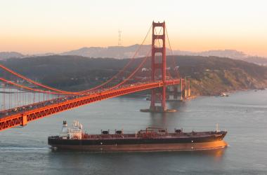 Cargo ship beneath San Francisco bridge