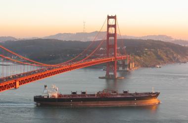 Cargo ship beneath San Francisco bridge
