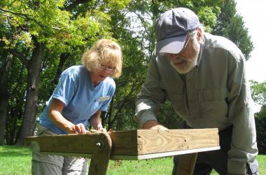 Jim Gibb and volunteer sieve soil