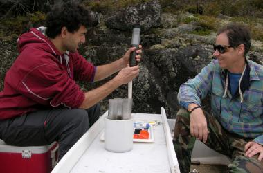 Scientists taking a sediment core for mercury analysis