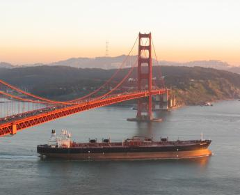 ship passing under the Golden Gate Bridge