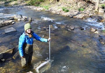 volunteer in the stream sampling for eggs