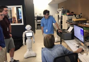 Students learning how to code Pepper robot.