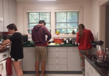 Interns cook in the kitchen