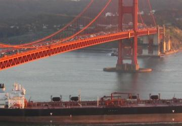 Cargo ship beneath Golden Gate Bridge, San Francisco