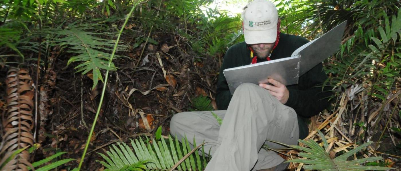 Researcher recording orchid distribution data
