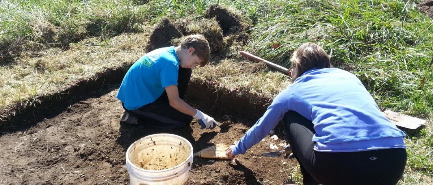 volunteers excavate plot