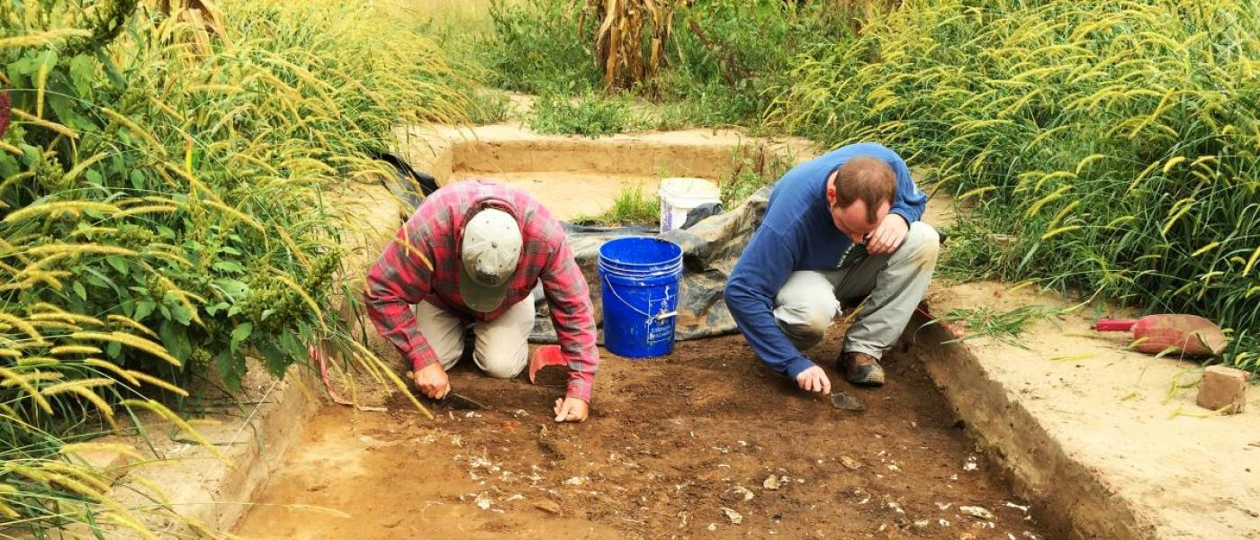 Two citizen scientists digging