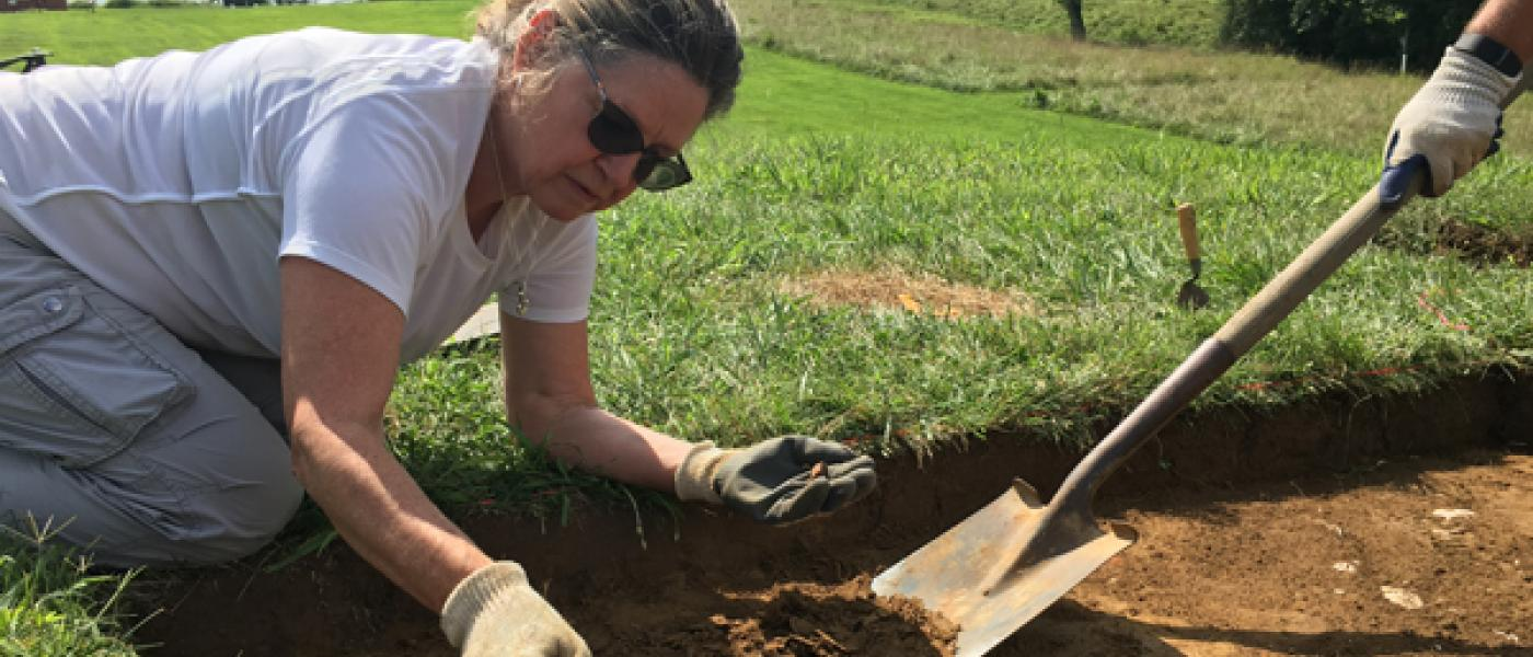 Woman digging through soil