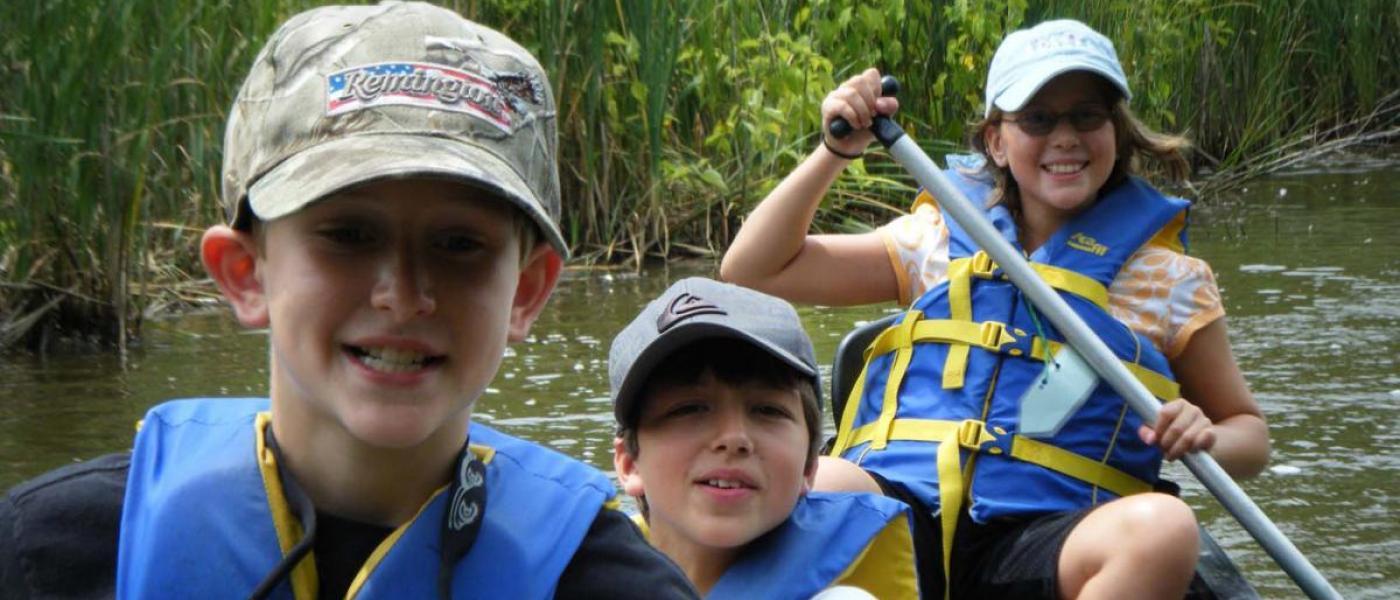 Family of three canoeing