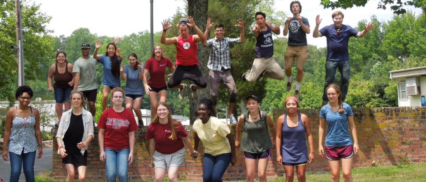2016 Summer Interns Jumping Off Wall