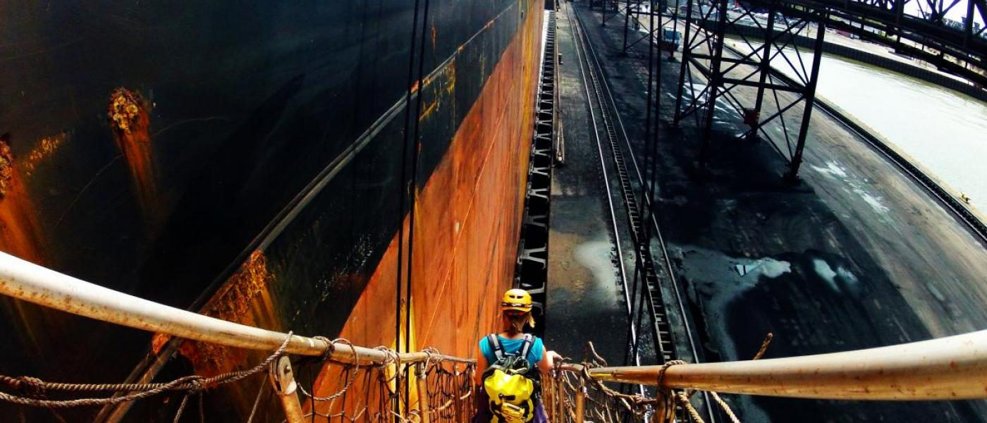Woman descends gangway of bulker ship