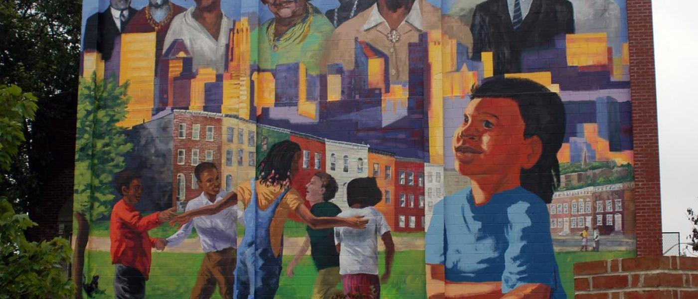 Mural with people painted on brick building in Baltimore