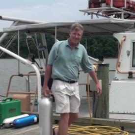 Man on dock by boat